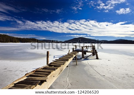 amazing sunny day on the froze lake - stock photo