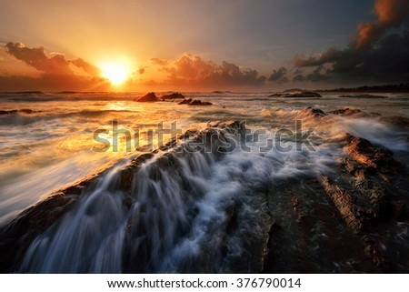 Amazing sunrise at the beach. Nature composition. - stock photo