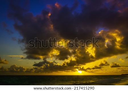 Amazing sunrise on the beach of Caribbean Sea