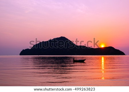 Amazing sunrise over small island in the Gulf of Thailand