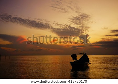 Amazing sunrise with silhouette image fishing boat view as a foreground.Soft focus due to long exposure shot.Nature composition:Ideal use for background.