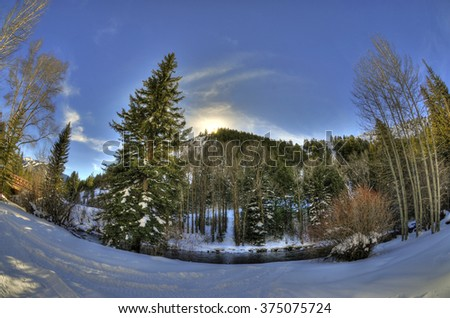 Amazing sunset behind a mountain in Aspen, Colorado through fisheye lens