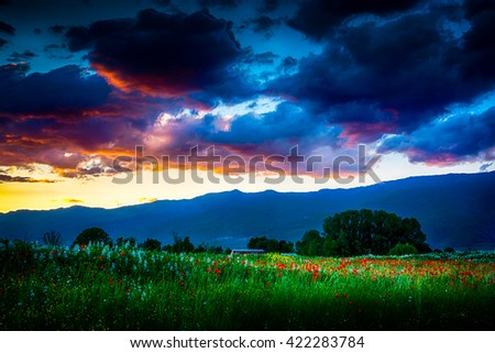 Amazing sunset clouds and poppies in Kerkini Greece in Spring