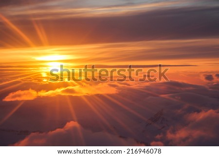 Amazing sunset in the clouds from the airplane over Iceland - nature background - stock photo
