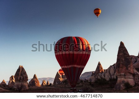 Amazing sunset over Cappadocia. Beautiful color balloons. Turkey.
