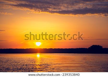 Amazing sunset over lake. Europe, Ukraine - stock photo