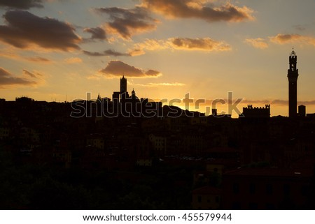 amazing sunset over the medieval city of Siena in Tuscany, with its towers and the cathedral
