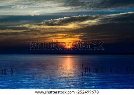 Amazing sunset over the sea. - stock photo