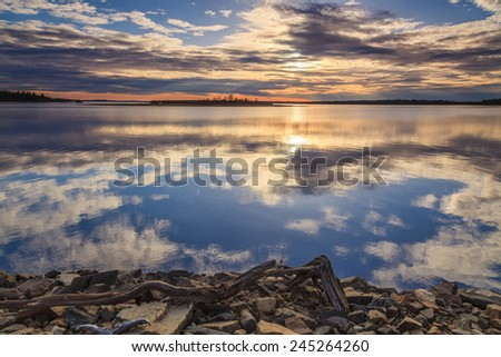 Amazing sunset reflection in a huge lake - stock photo
