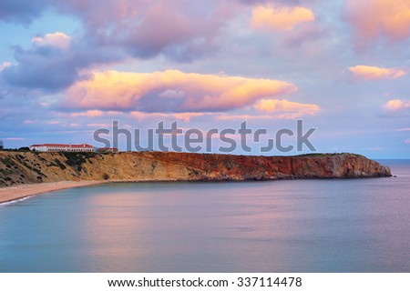 Amazing sunset view of Portugal ocean shore of Algarve region at sunset - stock photo