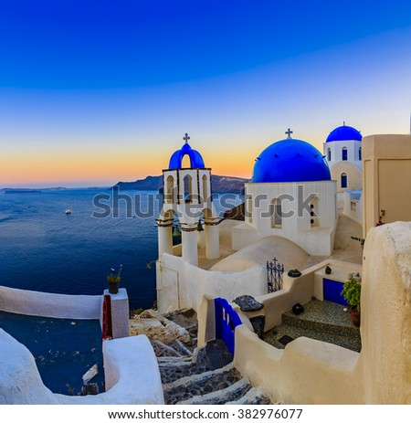 Amazing sunset view of stairs and church in Oia village on Santorini island in Greece.
