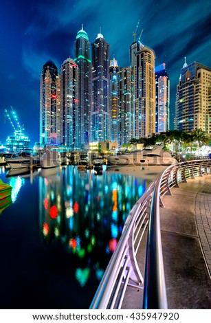 Amazing tallest residential panorama by night. The tallest residential buildings of the world. Dubai marina skyline, United Arab Emirates. - stock photo