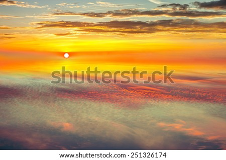 Amazing view from plane on the sky, sunset sun and clouds.  - stock photo