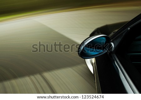 Amazing view of black car in turn - stock photo
