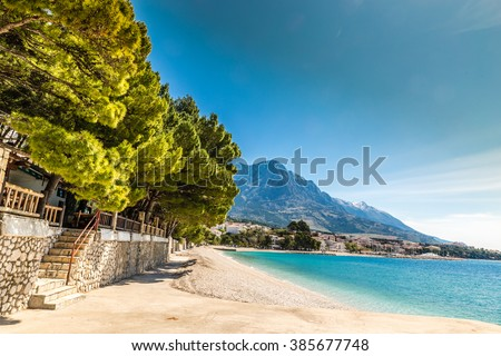 Amazing View Of Brela Village, Sea, Empty Beach And Biokovo Mountain - Brela, Makarska, Dalmatia, Croatia - stock photo