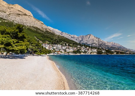 Amazing View Of Brela Village, Sea, Empty Beach And Biokovo Mountain - Brela, Makarska, Dalmatia, Croatia - stock photo