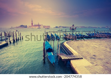 Amazing view of Grand Canal at sunset with San Giorgio Maggiore church. San Marco, Venice, Italy, Beauty world. Retro style filter. Instagram toning effect. - stock photo