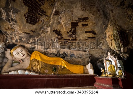 Amazing view of lot Buddhas statues and religious carving on limestone rock in sacred Kaw Goon cave. Hpa-An, Myanmar (Burma) travel landscapes and destinations - stock photo