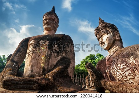 Amazing view of mythology and religious statues at Wat Xieng Khuan Buddha park. Vientiane, Laos - stock photo