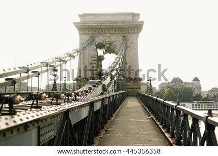 amazing  view of old bridge at river and sidewalk in the morning light in Budapest city, travel concept, space for text - stock photo
