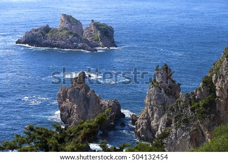 Amazing view of single stanging rocks in the blue bay