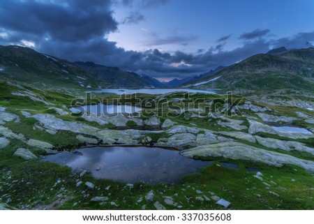 Amazing view of Totensee lake on the top of Grimselpass. Alps, Switzerland, Europe.