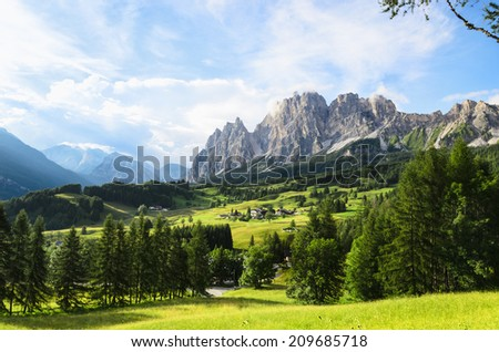 Amazing view on Cristallo Mountains with  alpine village on sunny summer day, , The Dolomites Mountains, Italy  - stock photo