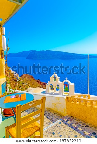 Amazing view to the sea including a multi Belltower from an old traditional church in Oia the most beautiful village of Santorini island in Greece - stock photo
