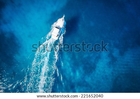 amazing view to yacht, swimming woman and clear water caribbean paradise - stock photo