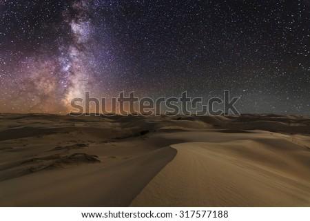 Amazing views of the Gobi desert under the night  starry sky. - stock photo