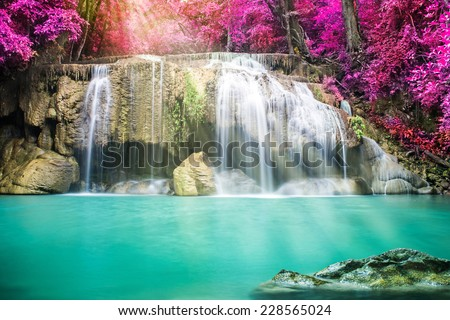 Amazing waterfall in autumn forest  - stock photo