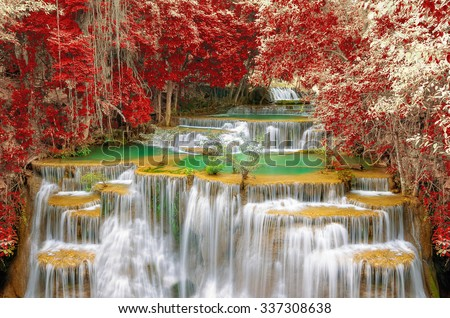 Amazing waterfall in colorful autumn forest, Kanchanaburi, Thailand. - stock photo