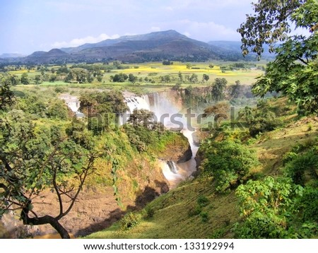Amazing waterfall with rainbow. Shot in Ethiopia. - stock photo