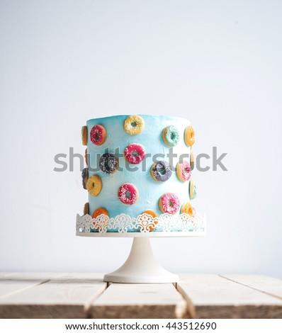Amazing wedding cake with donuts - stock photo