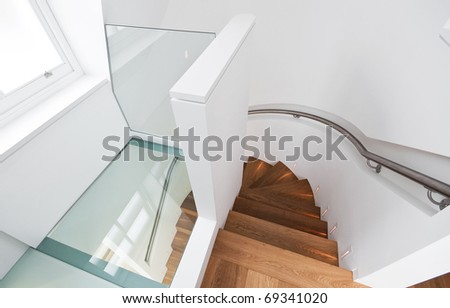 amazing wooden staircase with glass floor landing - stock photo