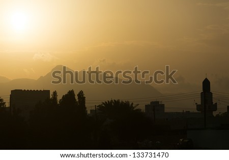 Amazingly beautiful sunset in the mountains, Oman - stock photo