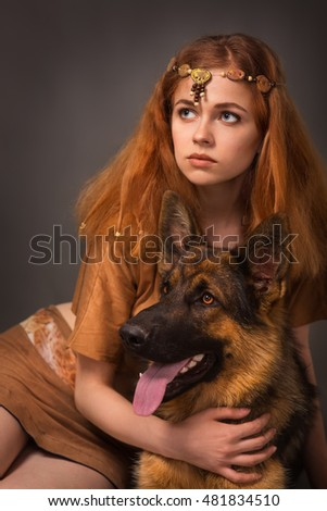 Amazon Girl in a suit with a dog