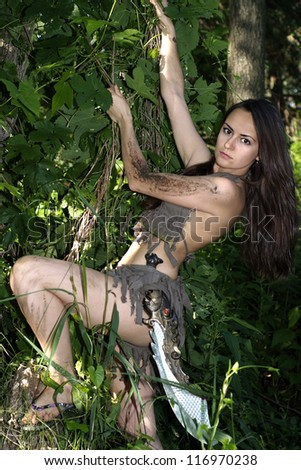 amazon woman posing with a loincloth on the nature - stock photo