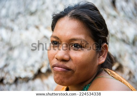 AMAZONIA, PERU - NOV 10, 2010: Unidentified Amazonian indigenous girl portrait. Indigenous people of Amazonia are protected by COICA (Coordinator of Indigenous Organizations of the Amazon River Basin) - stock photo
