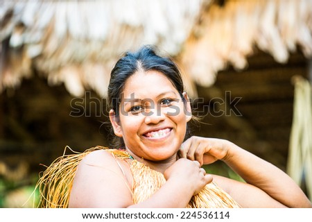 AMAZONIA, PERU - NOV 10, 2010: Unidentified Amazonian indigenous smiling beautiful girl. Indigenous people of Amazonia are protected by  COICA (Coordinator of Indigenous Org of the Amazon River Basin) - stock photo