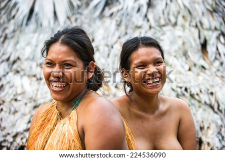 AMAZONIA, PERU - NOV 10, 2010: Unidentified Amazonian indigenous two women laugh.Indigenous people of Amazonia are protected byCOICA (Coordinator of Indigenous Organizations of the Amazon River Basin) - stock photo