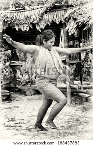 AMAZONIA, PERU - NOV 10, 2010: Unidentified Amazonian indigenous woman dances. Indigenous people of Amazonia are protected by  COICA (Coordinator of Indigenous Organizations of the Amazon River Basin)