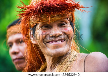 AMAZONIA, PERU - NOV 10, 2010: Unidentified Amazonian man smiles. Indigenous people of Amazonia are protected by COICA (Coordinator of Indigenous Organizations of the Amazon River Basin) - stock photo