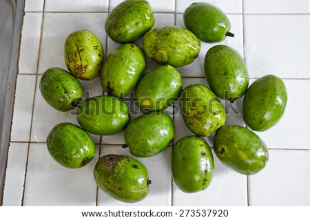 Ambarella or kedondong in Indonesia, a local fruit taste a bit sour - stock photo