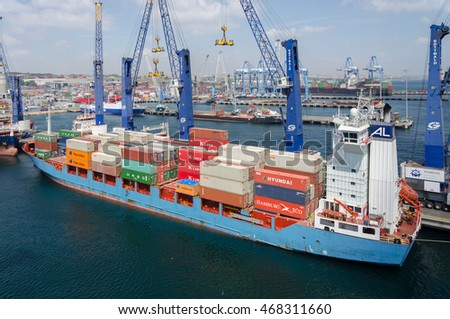 Ambarli, Turkey - August 08: Container vessel and cargo cranes at the container terminal of the port Ambarli on August 08, 2016  in Ambarli, Turkey.