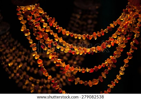 Amber beads in the market - stock photo