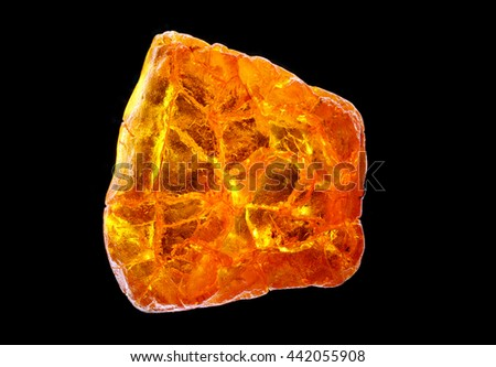 amber close up isolated on black background - stock photo