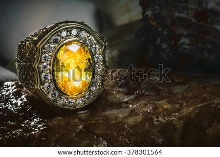 Amber diamond ring on the stone. - stock photo