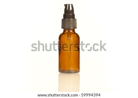 Amber Glass Bottle with pump lid - stock photo