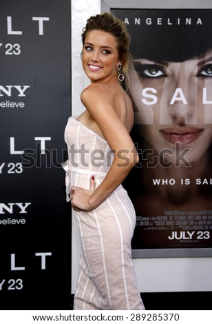 """Amber Heard at the Los Angeles premiere of 'Salt"""" held at the Grauman's Chinese Theatre in Hollywood on July 19, 2010.  - stock photo"""